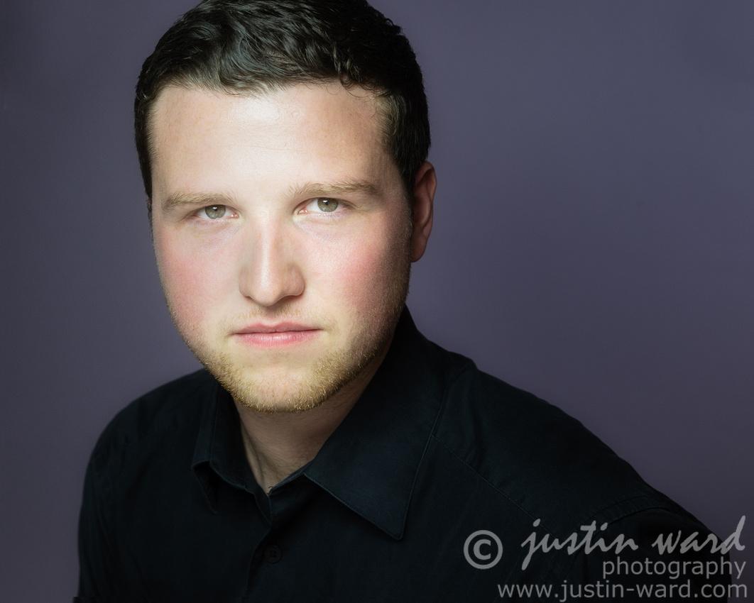 Danny Standing baritone studio headshot image
